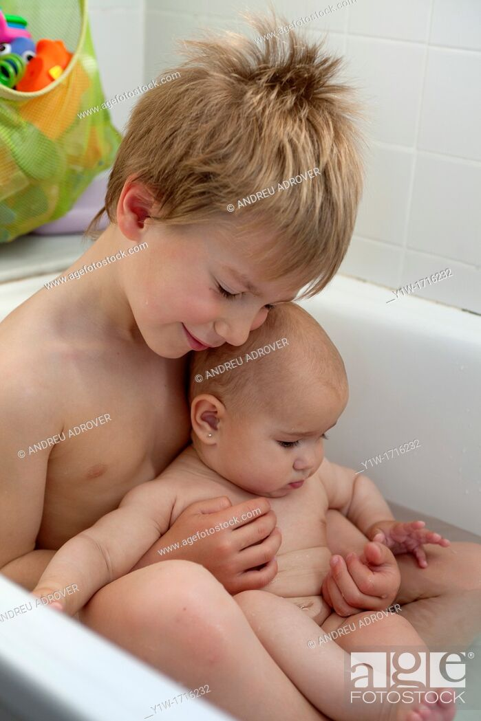5 year old boy and his 6 months old sister in bathtub, Stock Photo ...