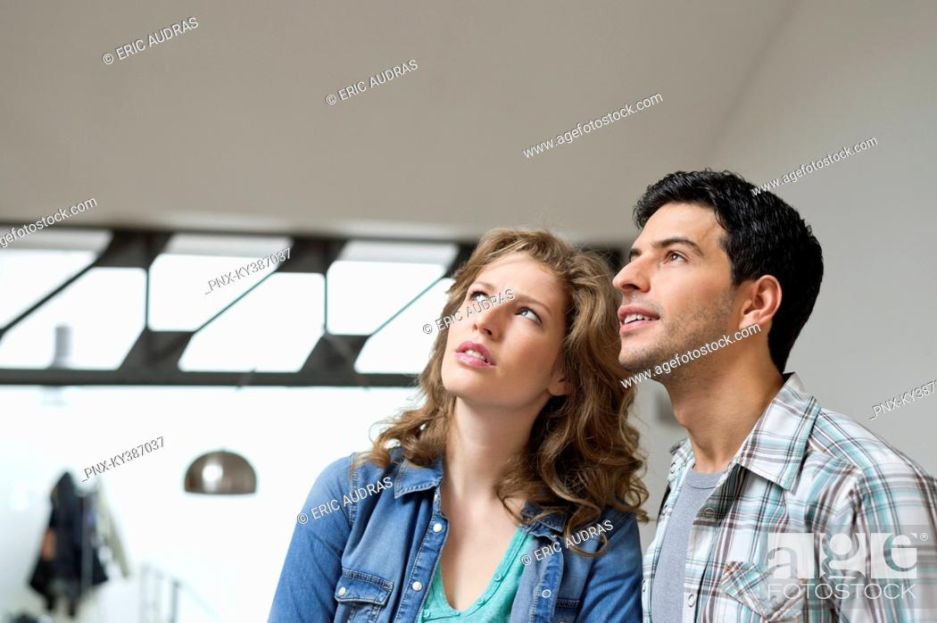 Stock Photo: Close-up of a couple looking up.