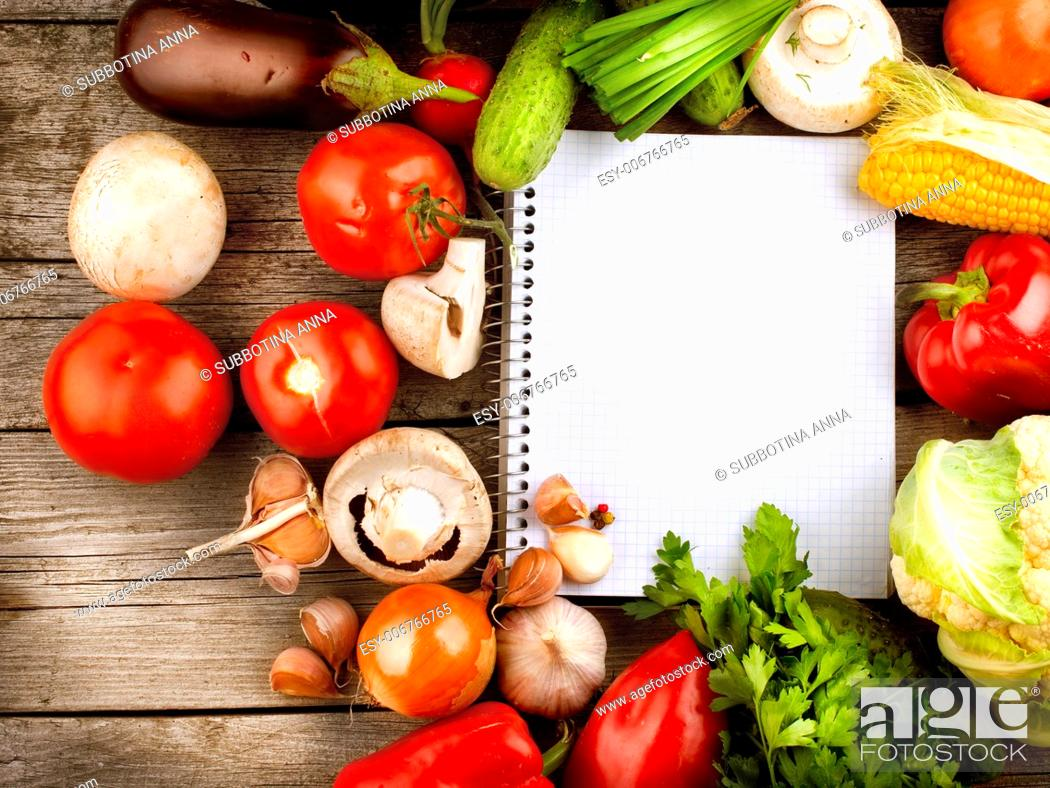 Stock Photo: Open Notebook and Fresh Vegetables Background. Diet.