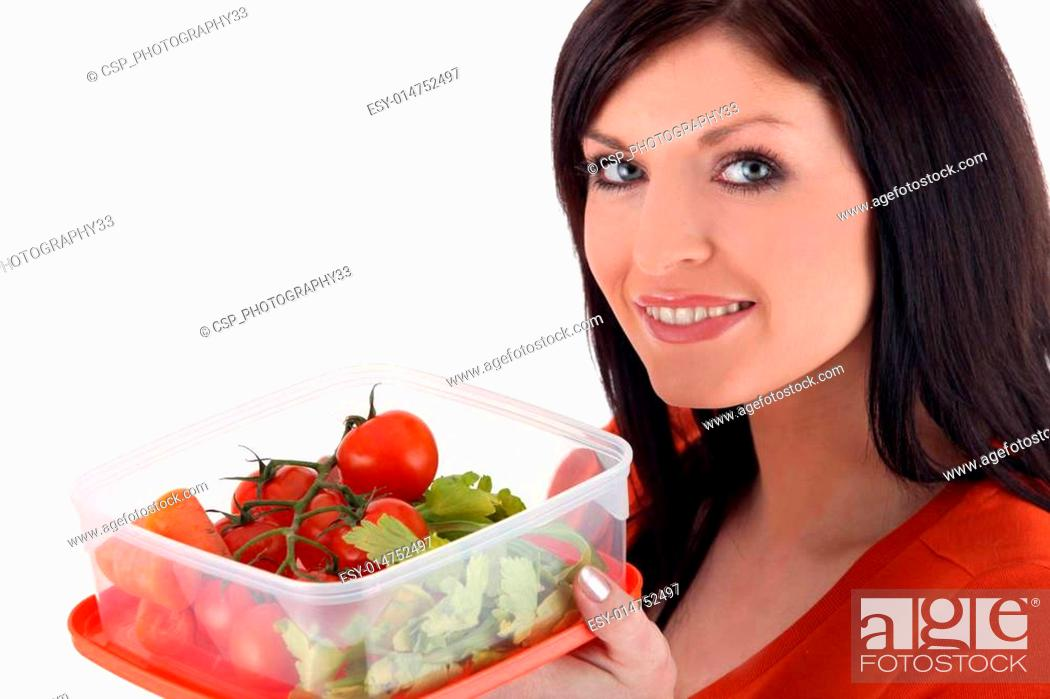 Stock Photo: Woman with a plastic lunch box of fresh vegetables.