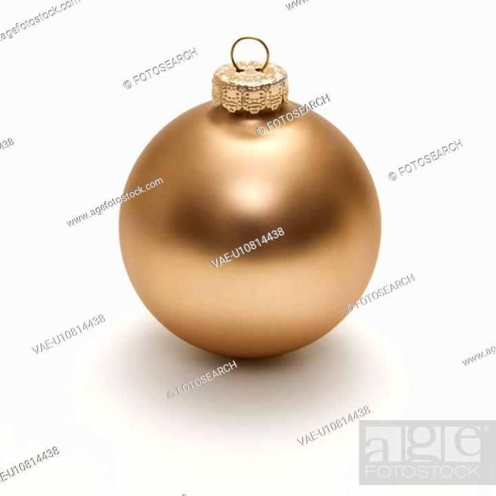 Stock Photo: Still life of gold Christmas ornament.