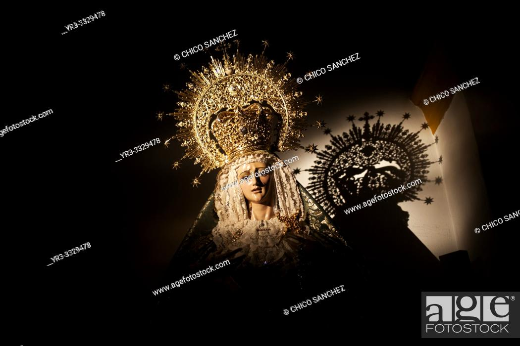 Stock Photo: The shadow of a crowned image of the Virgin Mary is cast during Semana Santa in the church of Prado del Rey, Sierra de Grazalema, Cadiz province, Andalusia.