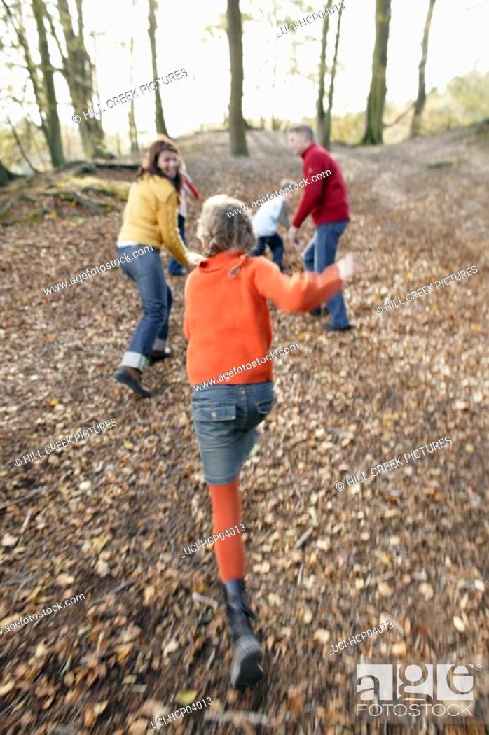 Stock Photo: Family playing in forest.