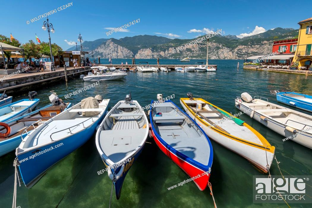Stock Photo: Fishing boats in the harbour of Malcesine village, Lake Garda, Italy.