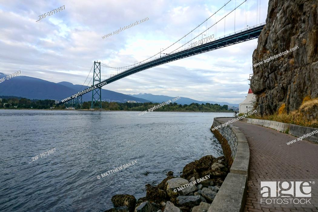 Stock Photo: Looking out at the Lion's Gate Bridge from the beautiful seawall of Stanley Park, Canada.