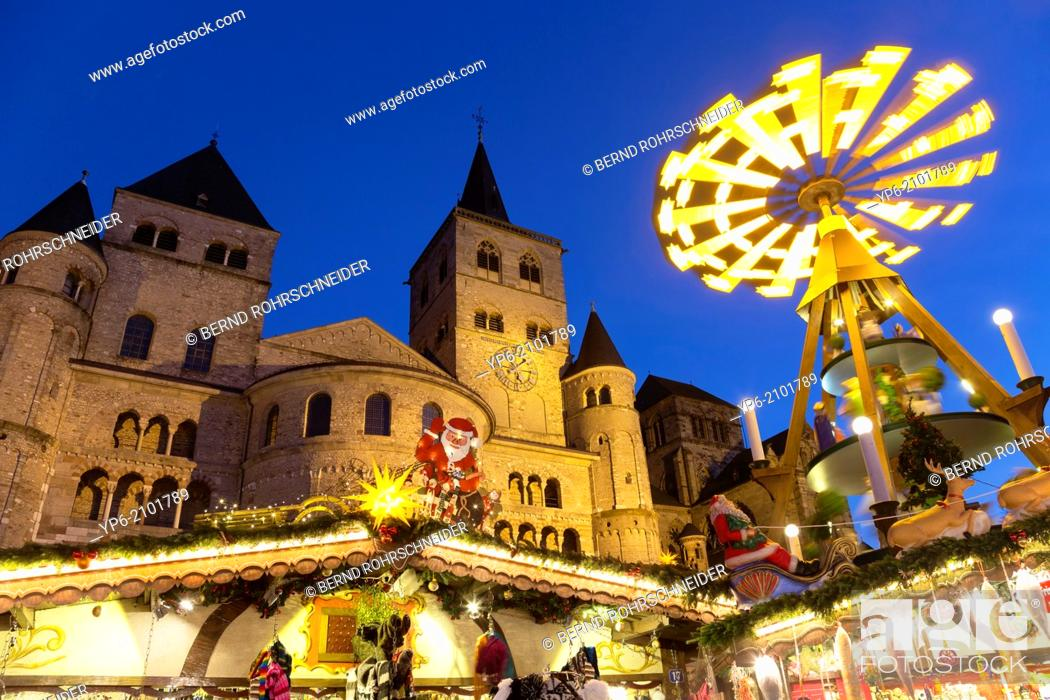 Stock Photo: Cathedral of Trier and Christmas market with pyramid at night, Trier, Germany.