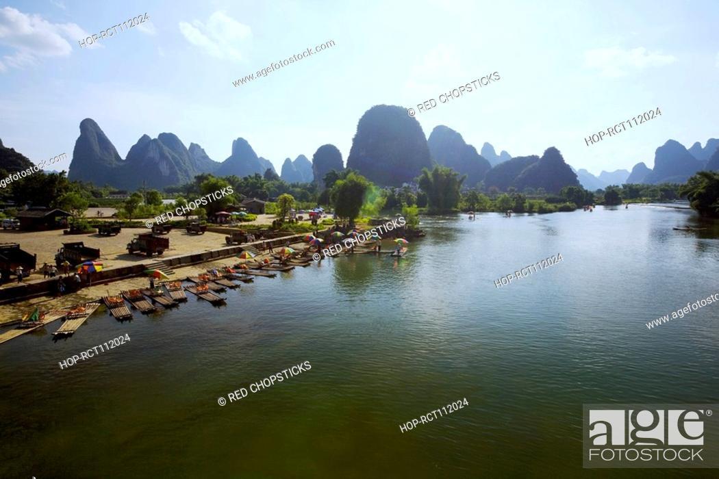 Stock Photo: Hills along a river, Guilin Hills, XingPing, Yangshuo, Guangxi Province, China.