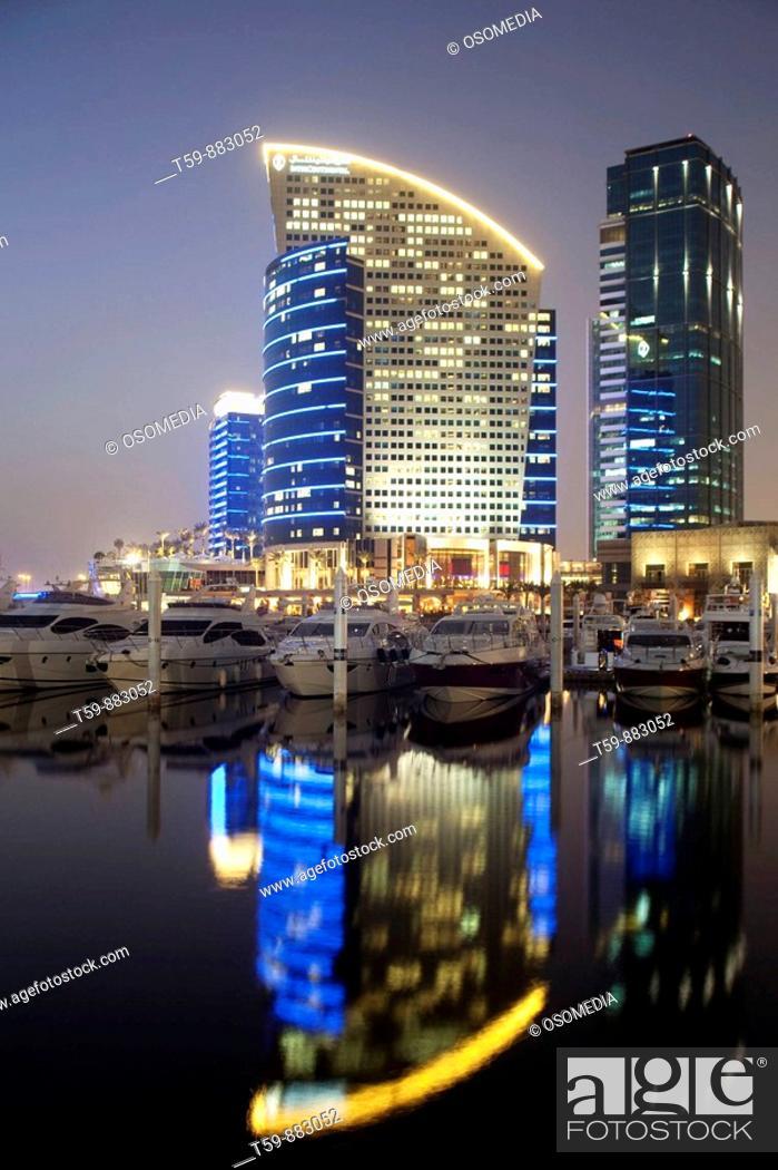 Stock Photo: Festival city with marina harbour at dusk , Dubai, United Arabian Emirates.