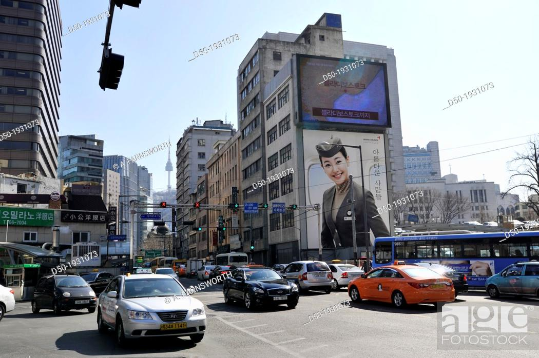 Stock Photo: SEOUL SOUTH KOREA Downtown crossing and Seoul Tower in background.