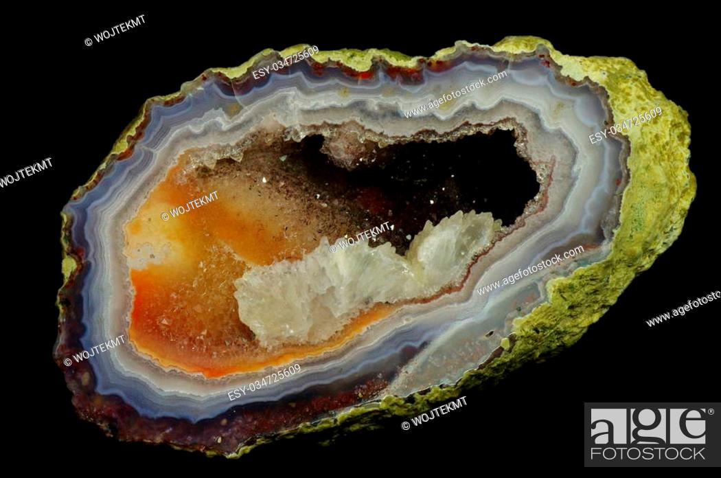 Stock Photo: A cross section of agate stone with geode on a black background. Origin: Morocco, Asni. Andrzej Kuzma collection.