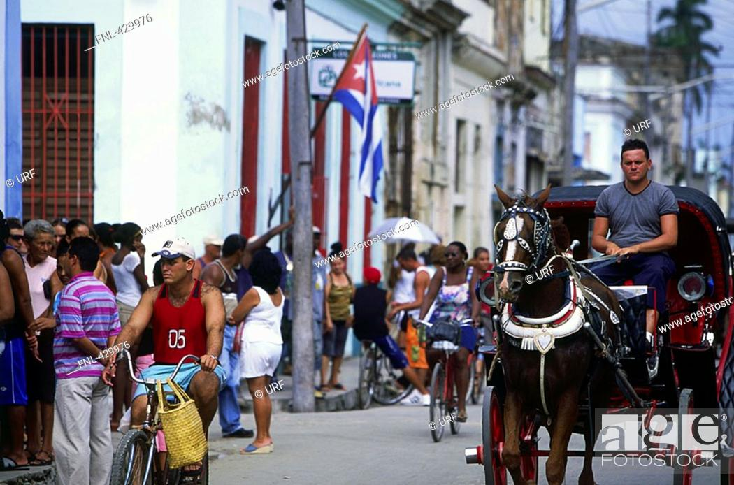 Stock Photo: Horse cart in crowded street, Cuba.