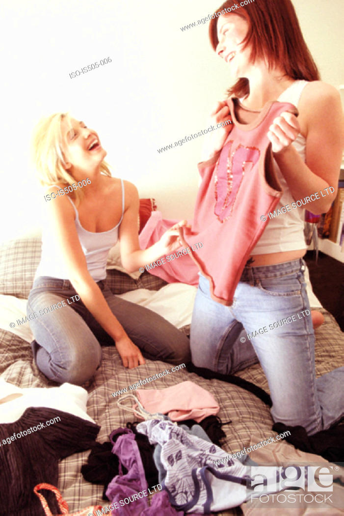 Stock Photo: Women sharing clothes.
