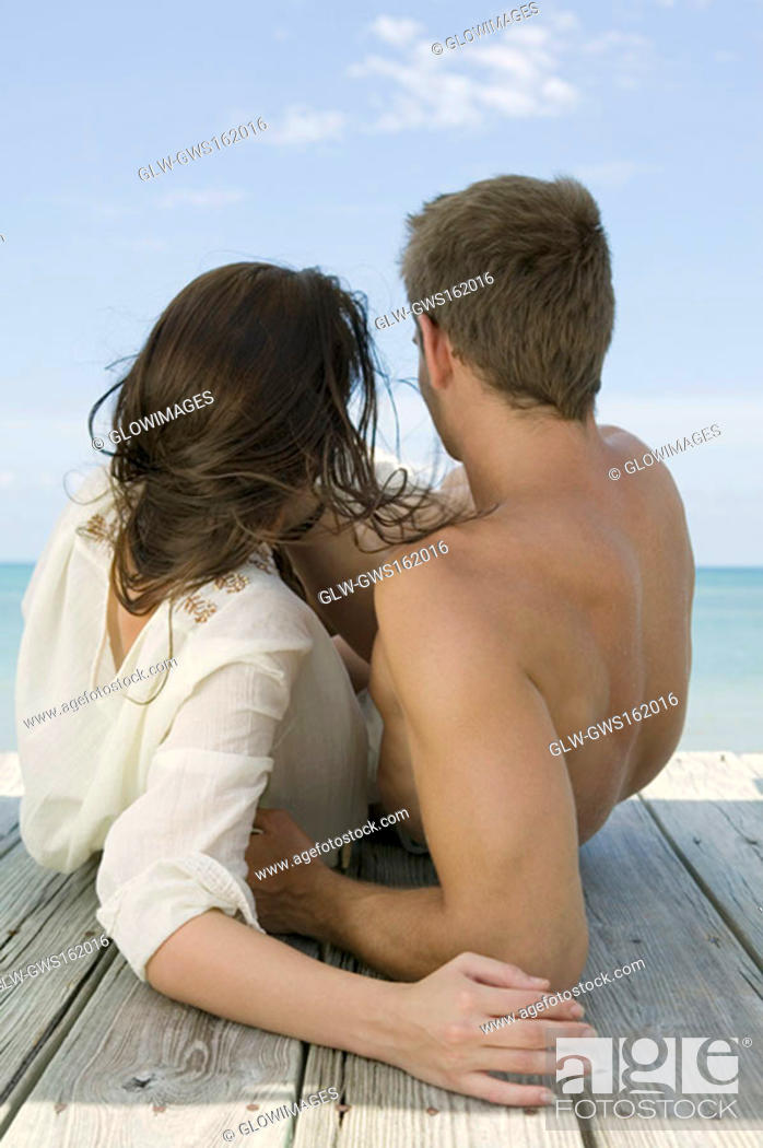 Stock Photo: Close-up of a young couple lying on a pier.