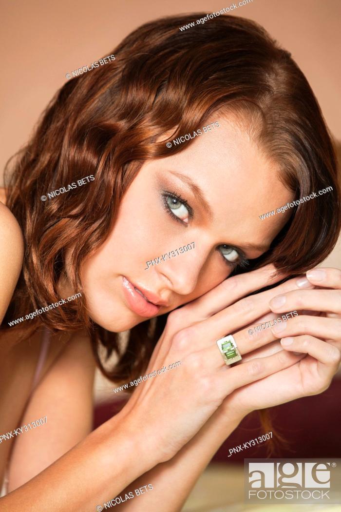 Stock Photo: Young woman looking at camera.
