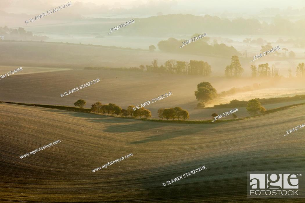 Stock Photo: Misty sunrise in South Downs National Park near Alfriston, East Sussex, England.