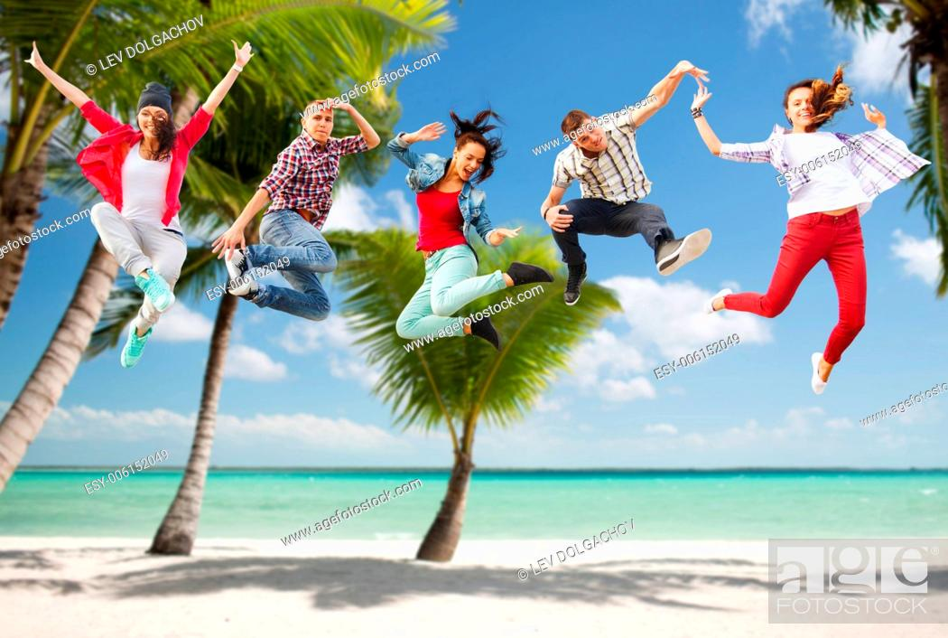 Stock Photo: summer, sport, dancing, vacation and teenage lifestyle concept - group of teenagers jumping.