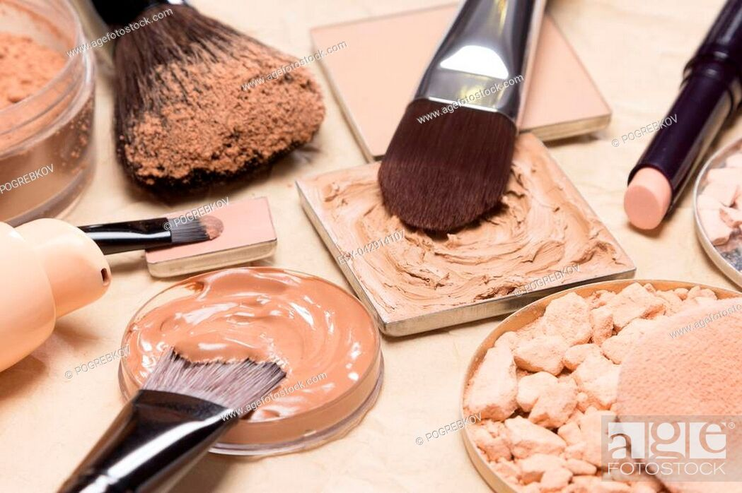 Stock Photo: Foundation, powder, concealer with make-up brushes on crumpled paper. Corrective makeup products and accessories close-up, selective focus.