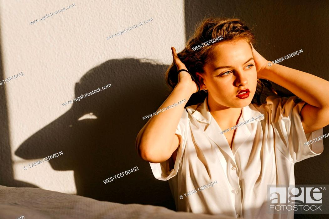 Stock Photo: Portrait of beautiful young woman at home.