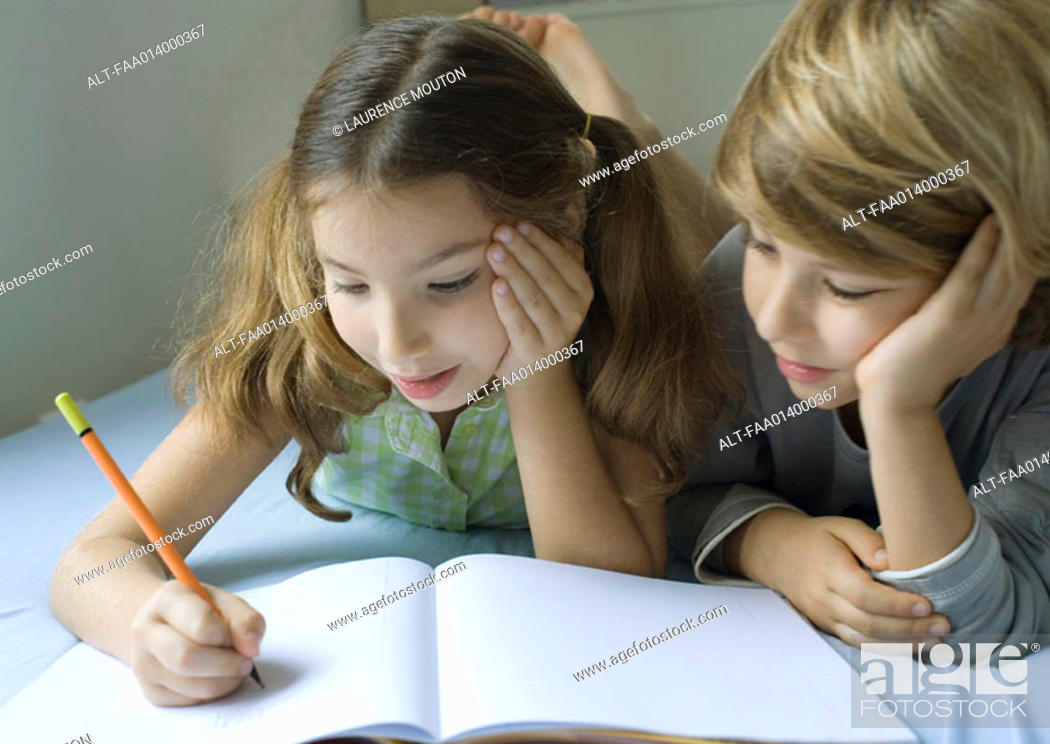Stock Photo: Two children doing homework together.
