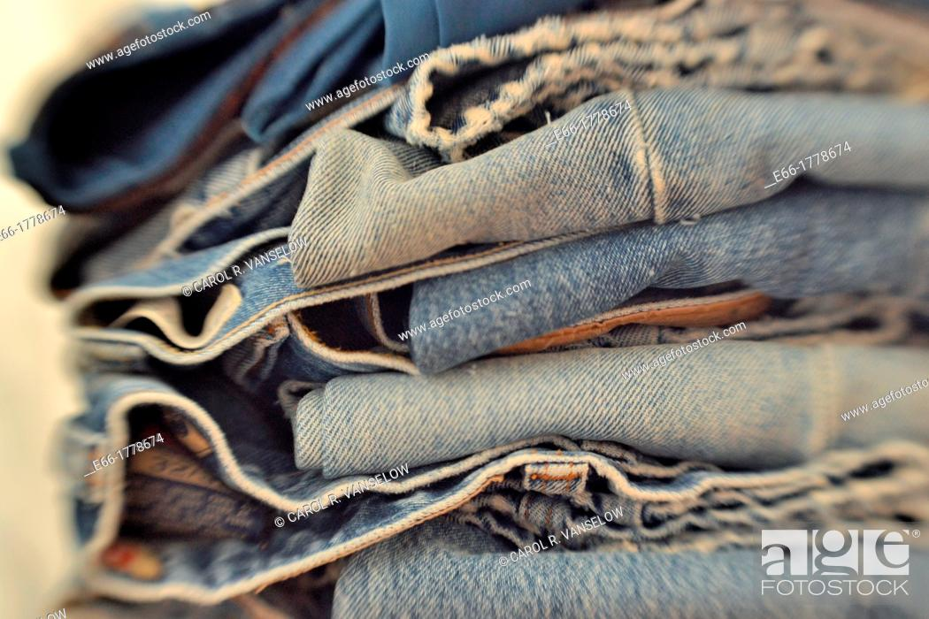 Stock Photo: Stack of folded pairs of blue jeans  Shot with LensBaby for selective focus.