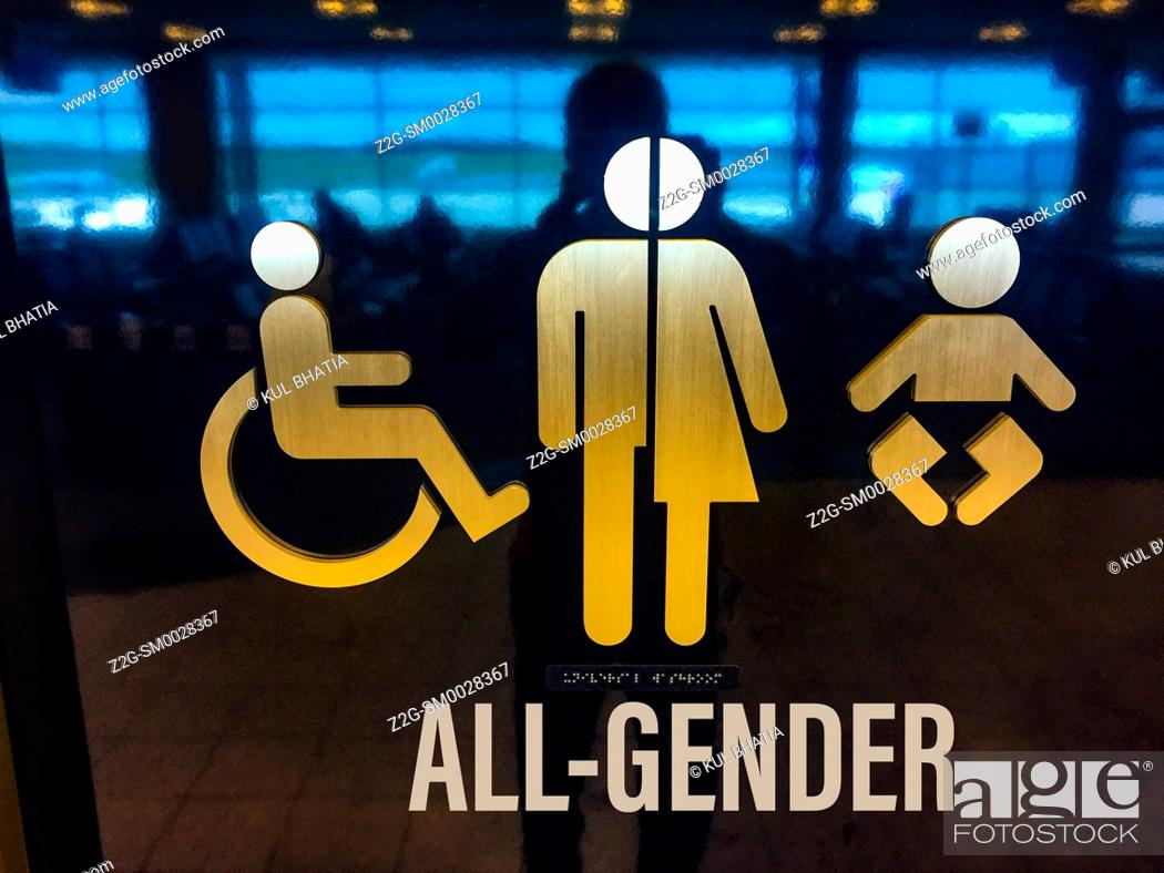 Stock Photo: A pictograph, words, and Braille sign for an all gender washroom, Canada.