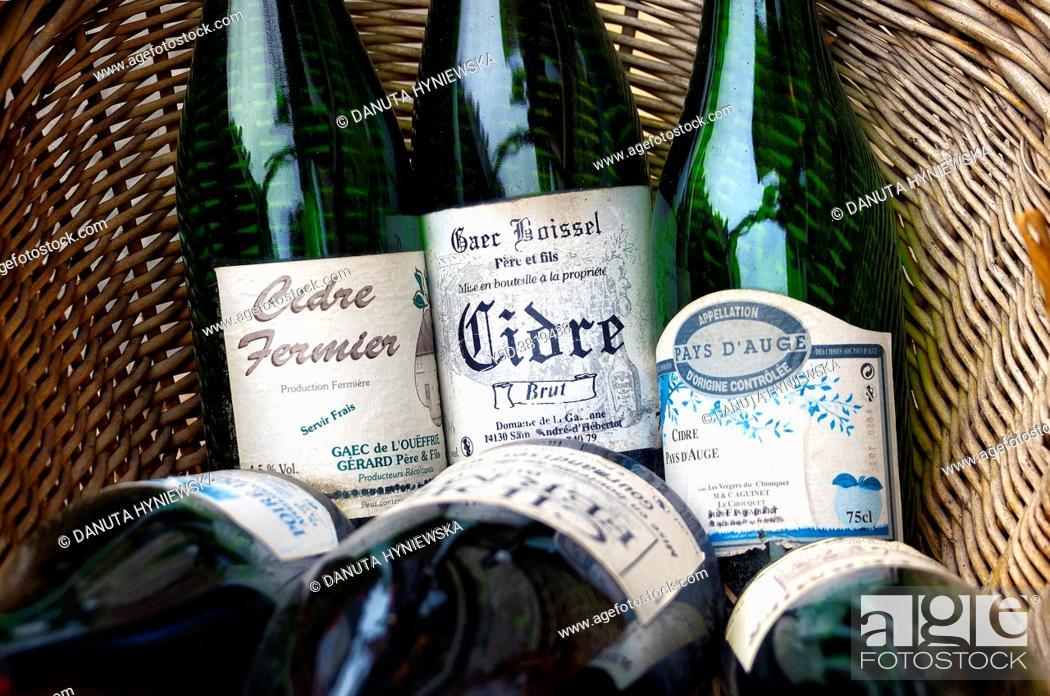 Stock Photo: Bottles of cider in basket. Honfleur. Normandy, France, Europe.