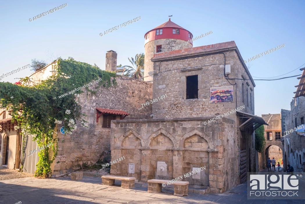 Stock Photo: Three fountains on the facade of an old building in the medieval city inside of Fortifications of Rhodes. Greece.