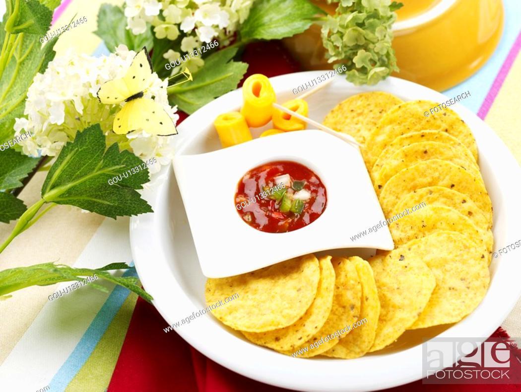 Stock Photo: napkin, chili sauce, tablecloth, butterfly, flower, pan, nachos.