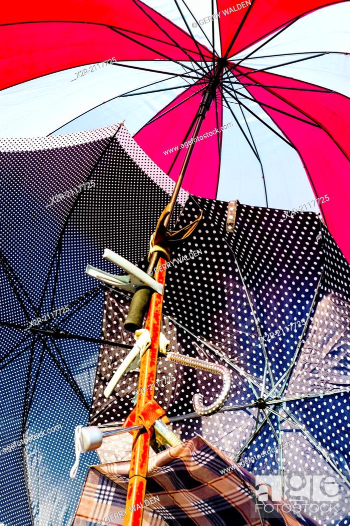 Stock Photo: Colourful umbrellas for sale in a street market.
