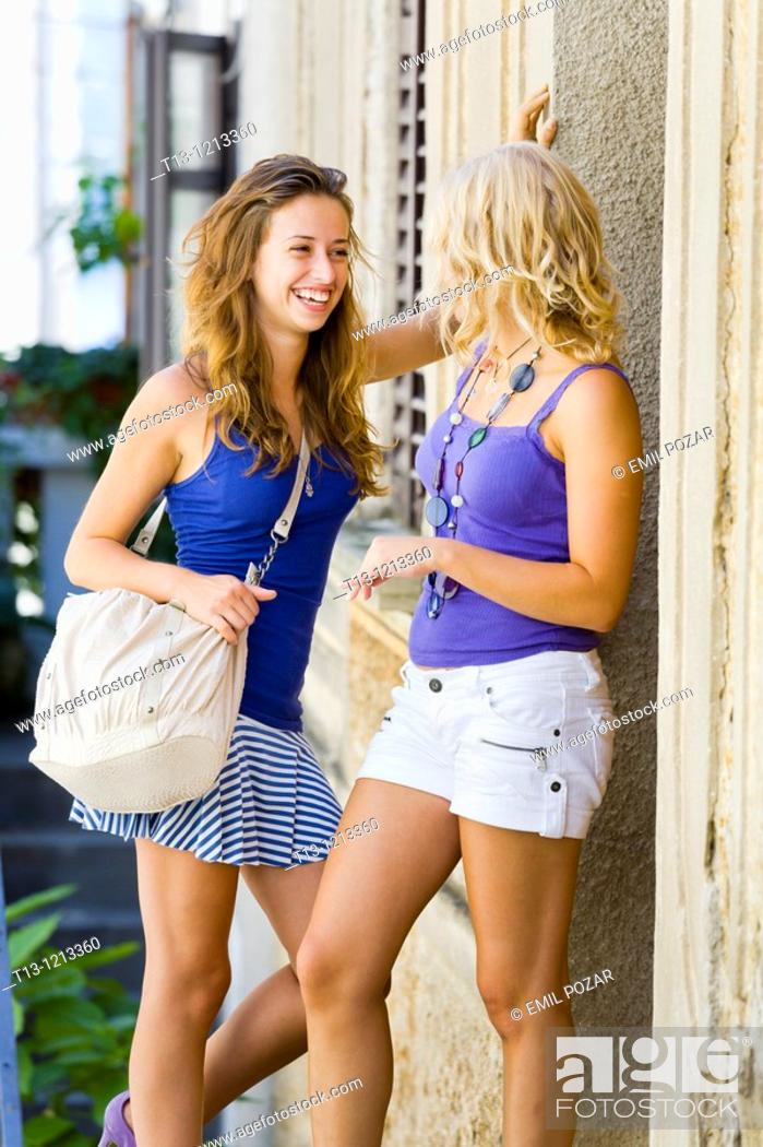 Stock Photo: great laugh, two young women together on the street.