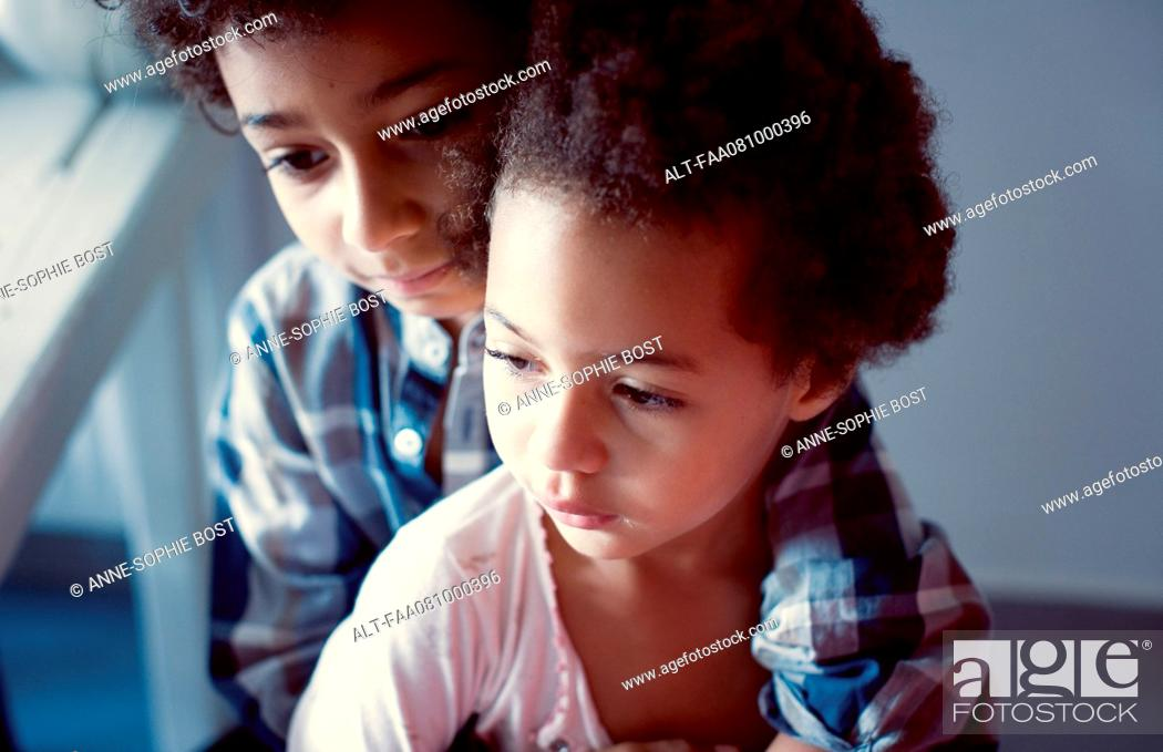 Stock Photo: Young brother and sister, portrait.