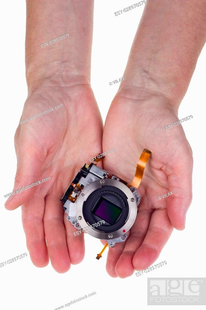 Stock Photo: Modern hi-tech image sensor for a mass production camera in worker hands for you. Isolated on white.