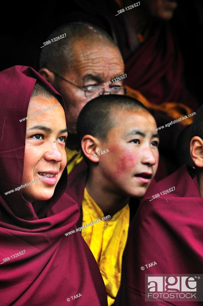 Stock Photo: Young Buddhist monks watching Chaam Musk Dancing at Hemis Gompa. Jammu and Kashmir, India.