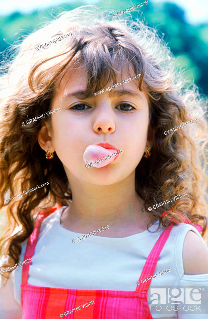 Stock Photo: Young girl blowing chewing gum bubble.