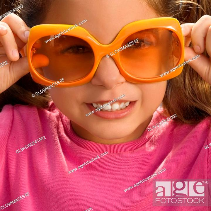 Stock Photo: Close-up of a girl wearing an oversized sunglasses.