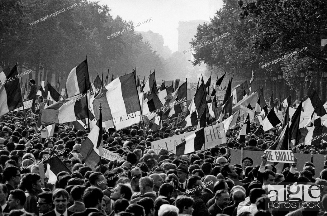 Stock Photo: A huge crowd parading along the Champs Elysées to support the President of French Republic Charles de Gaulle during the May 1968 events in France.