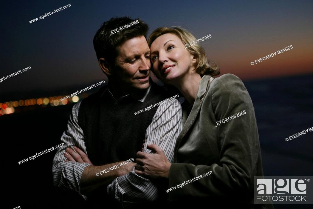 Stock Photo: Mature couple star gazing.