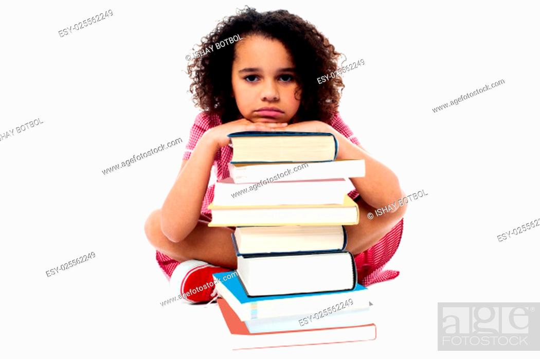 Stock Photo: Tired schoolgirl resting her arms on books.