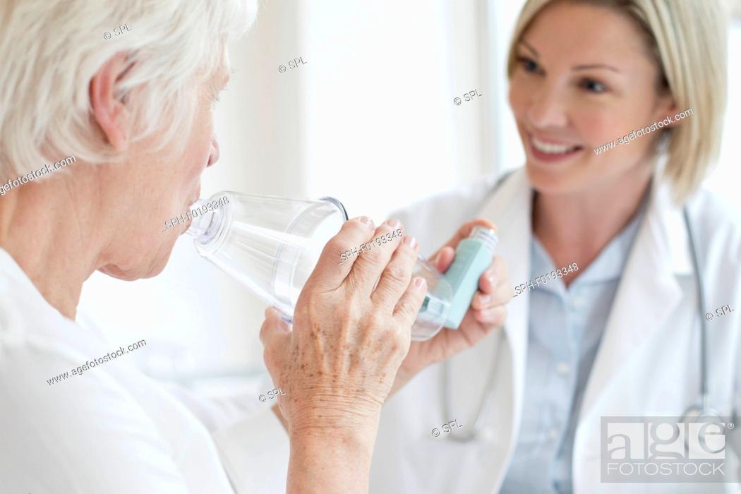 Stock Photo: Senior woman using inhaler.