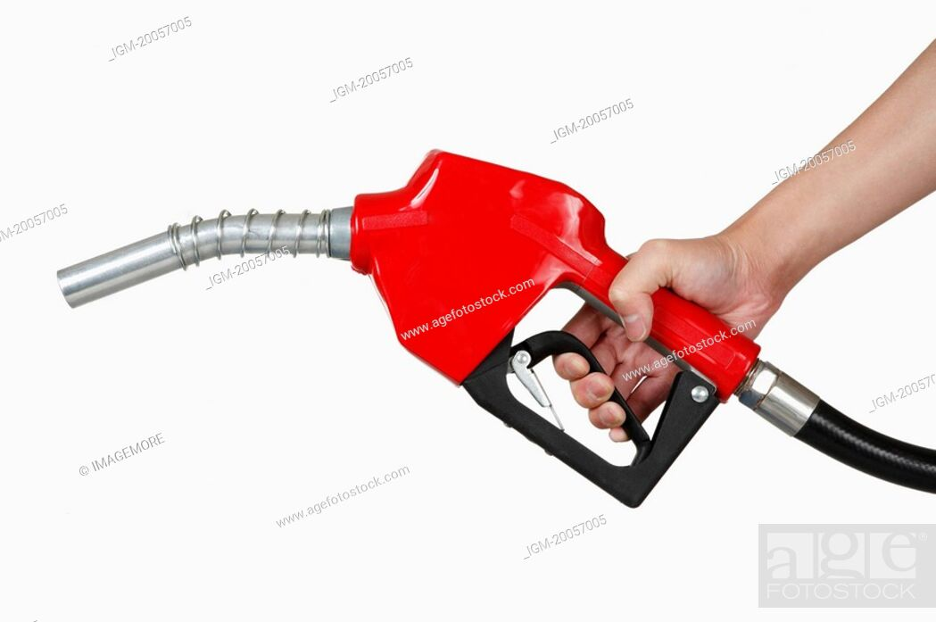 Stock Photo: Human hand holding a fuel pump.