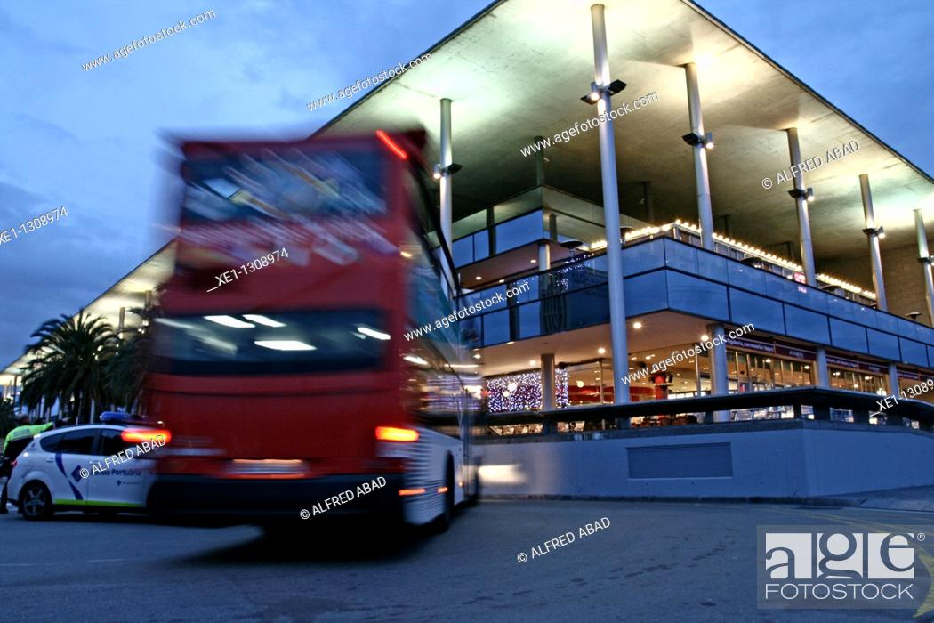 Stock Photo: Tourist Bus in front of the Maremagnum shopping center, Barcelona, Catalonia, Spain.