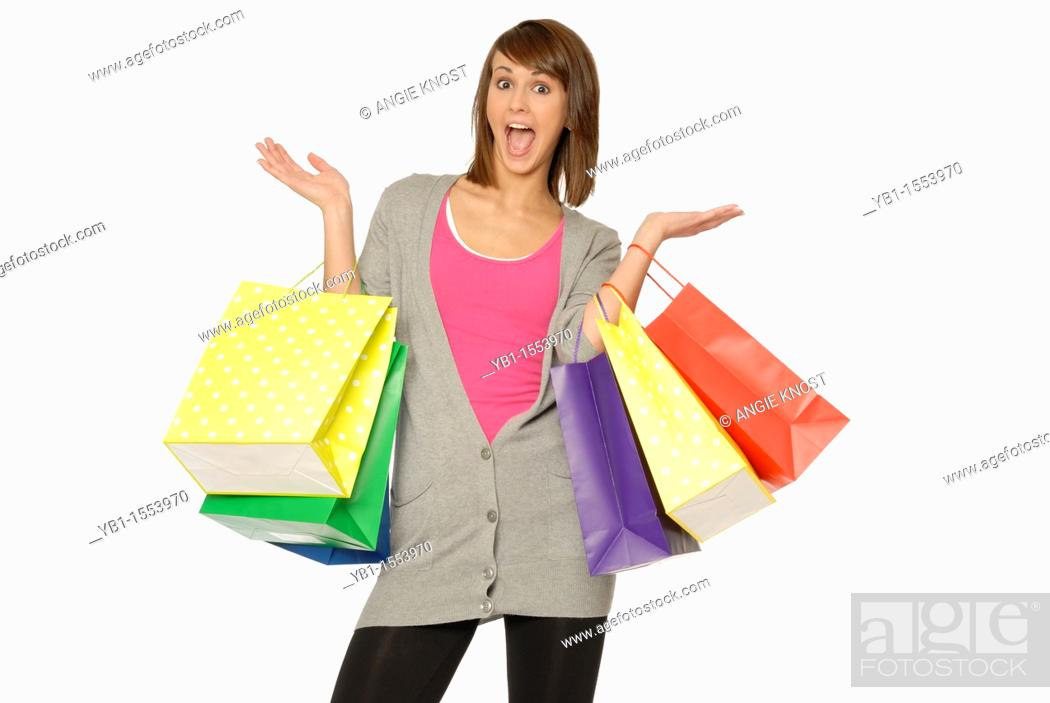 Stock Photo: Pretty Young Woman With Excited Expression, Holding Many Bright Colored Shopping Bags.