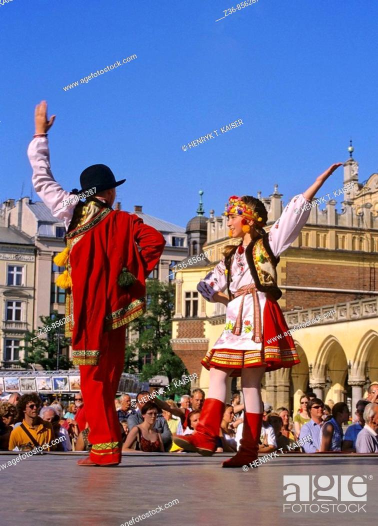 Stock Photo: Poland, Krakow, Folk dance festival at Main Market Square.