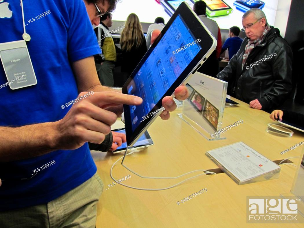 Stock Photo: Paris, France, Man Holding IPAD Tablet Compter in Hands, Apple Store.