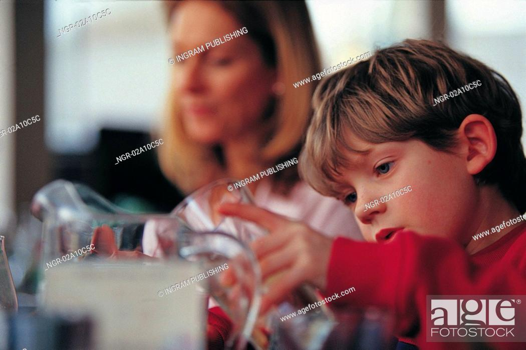 Stock Photo: mother and son at the table.