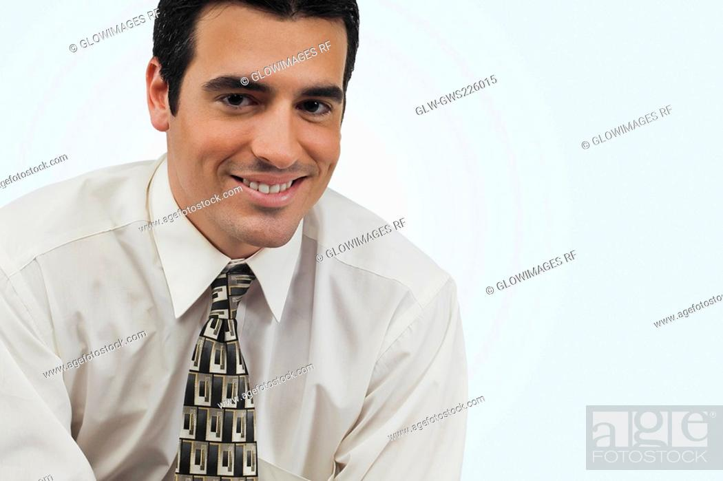 Stock Photo: Portrait of a businessman smiling.
