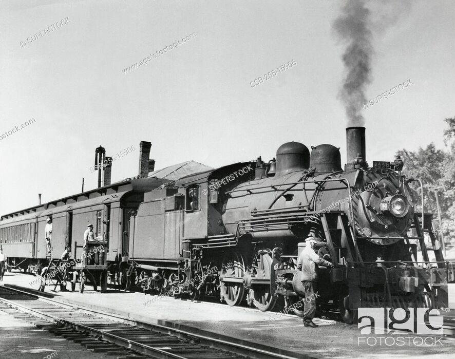 Stock Photo: Passenger train on railroad track, Boston and Maine Railroad, Worcester, Massachusetts, USA.