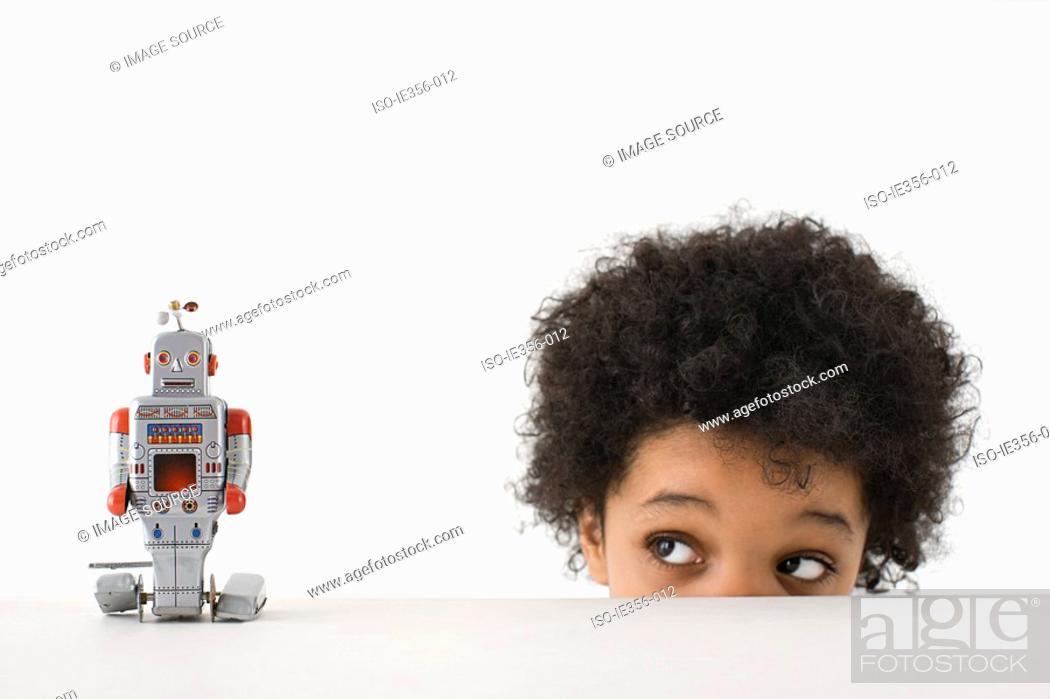Stock Photo: Boy looking at robot.
