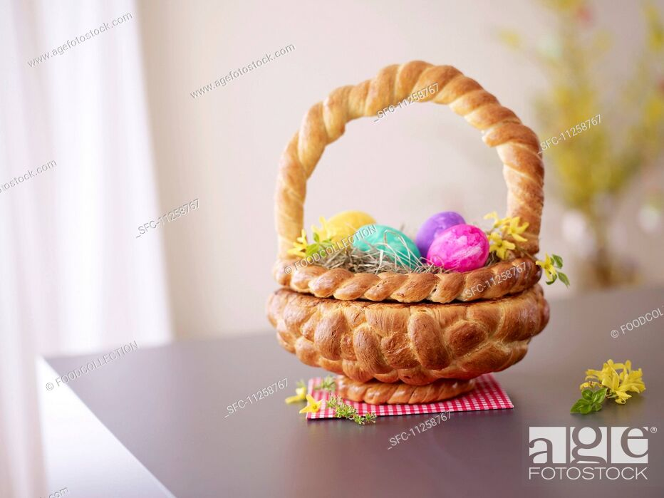 Photo de stock: A Easter basket made of bread filled with Easter eggs.