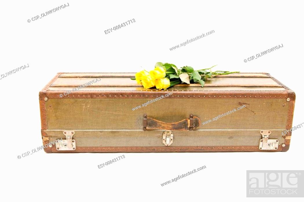 Stock Photo: an old fashioned suitcase isolated on white.